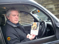 Edinburgh taxi driver with copy of The Lost World on launch day.