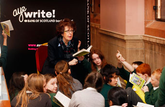 """The Aye Write! Bank of Scotland Book Festival was launched on 5 March with readings from The Lost World at Kelvingrove Art Gallery and Museum. Children from local schools joined Baillie Cameron (former Lord Provost),Chair of Culture and Sport Glasgow in reading the book. Baillie also discussed The Lost World with members of the Patrick VIP Book Group who had held their meeting at the museum."