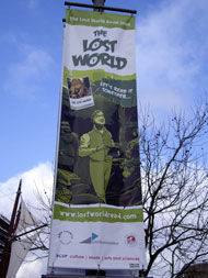 A Lost World Read 2009 banner in Bristol city centre depicting Darwin.